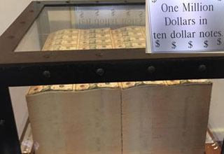one million dollars in 10 dollar bills inside a glass case