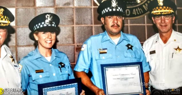 two police officers holding awards