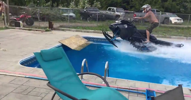 a man riding a snow mobile through the pool