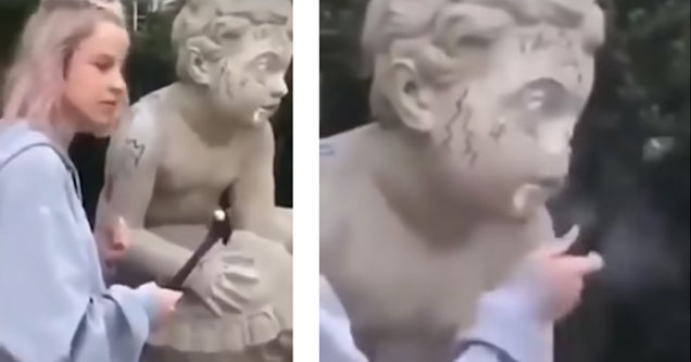 a girl breaking an 18th century statue with a hammer
