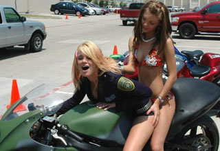 two hot chicks in bikinis on a motorcycle