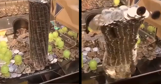 a coin pusher game with a huge pile of coins at the edge as the jackpot