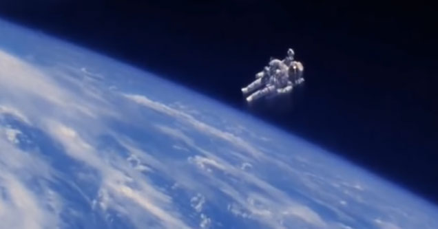 an astronaut in a jet pack way above the earths orbit