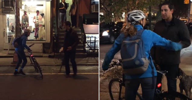 a man in the street facing off with a lady on a bicycle