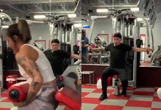 a lady grabbing gym equipment and then falling backwards