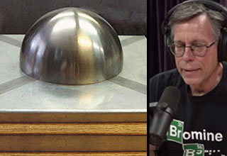 a metal dome on a metal plate and a photo of bob lazar