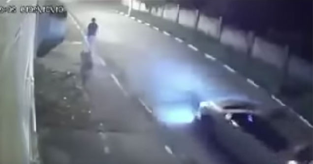 guy walking down the street late at night runs away from kidnappers