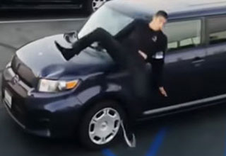 a skater jumping a wall and crashing into an illegally parked car