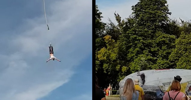 a man falling out of a bungee harness and landing on an airpad below