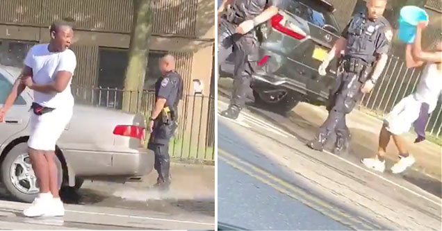NYPd get drenched with buckets of water on a hot summer day