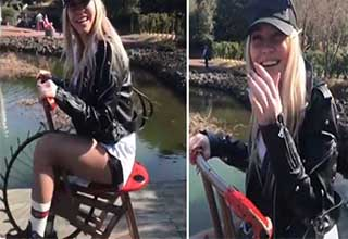 Blonde girl rides bike that doubles as sex toy
