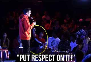 Comedian Andrew Schulz interacts with a wheelchair-bound heckler