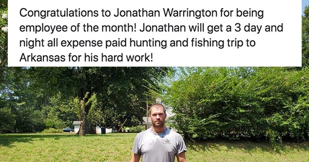 a man standing in a field with an employee of the month announcement above him