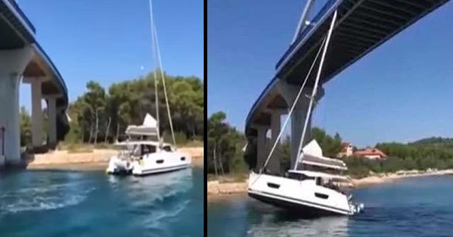 a sailboat yacht that got stuck under a bridge