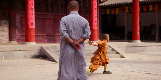 a shaolin master watches a monk take the final test
