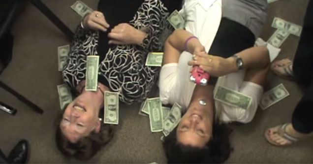 realtors have money showered on them in bizarre training video