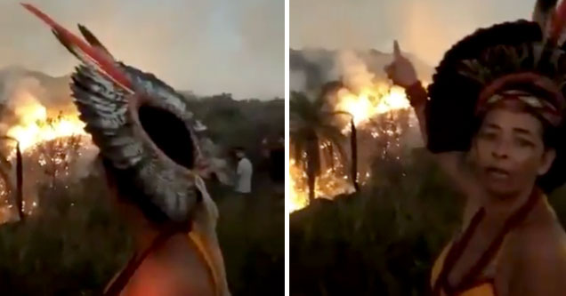 Indigenous Woman  cries as she watches the Amazon burn behind her