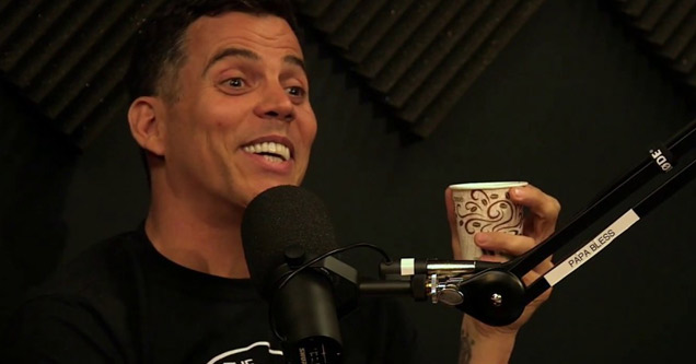 steve-o smiling into a microphone during an interview