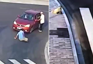 a man getting nailed by a car after he didn't use the crosswalk