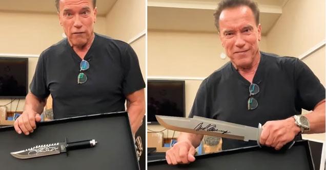 arnold Schwarzenegger holding a giant signed knife
