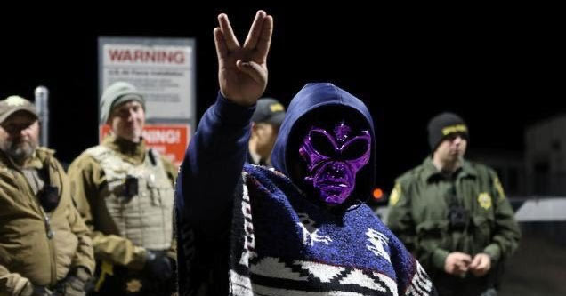 area 51 guards and a purple alien doing the spock V sign