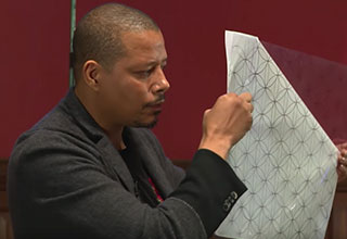 Terrance Howard holding up the flower of life while speaking at Oxford University