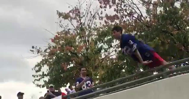 a man leaping over the railing at a tailgate for the titans bills game