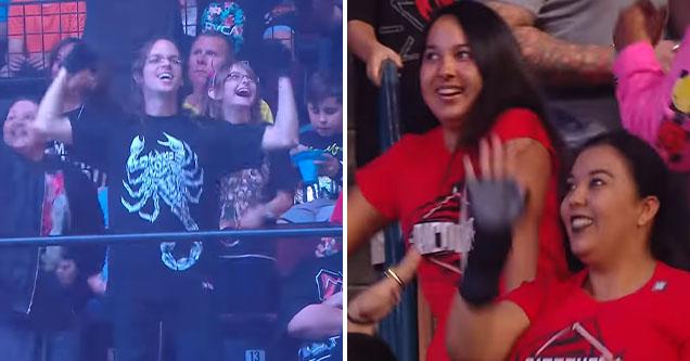 crowd dances awkwardly during WWE dance break