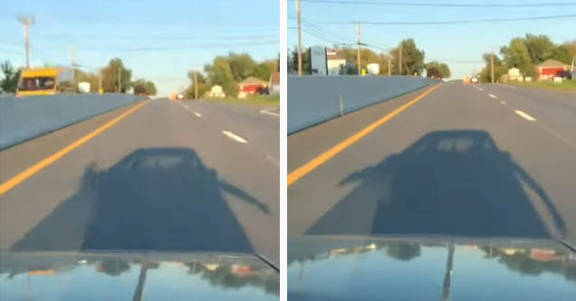 a truck with dude's arms out of it cruising down the highway