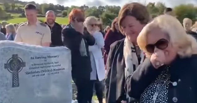 people laughing and crying during a funeral