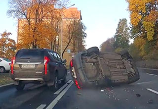 a car flipped over on a russian highway