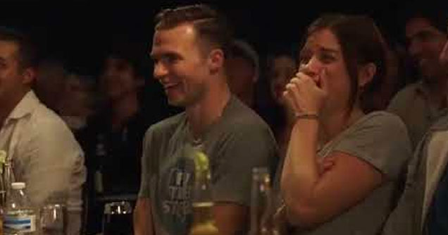 an audience member laughing at david spade's driver telling jokes