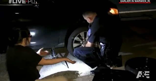 woman wont stop hitting on cop changing her tire