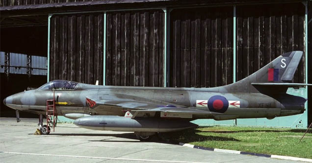 a british jet in a museum hangar