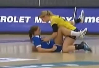 Handball hotties crash into each other