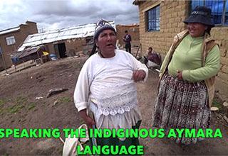 two women talking to a tourist to their village