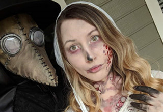 an antivax couple costume as doctors from the 1800s and handmaidens tale