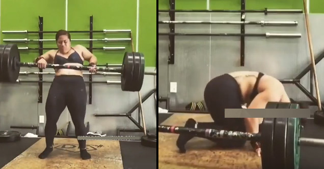 a woman lifting weights and falling down with them