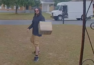 a fed ex employee throwing a package