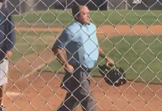 a youth baseball umpire walking off the field