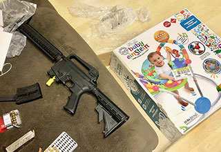 gun found inside a baby toy sold from a Florida goodwill
