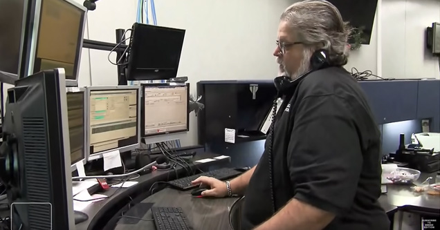 a 911 operator at his standing desk