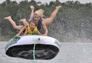 a girl and her son on a raft flying in the air