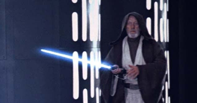 obi wan holding a lightsaber while standing in a spaceship