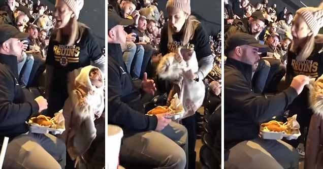 woman yelling at a man in a crowd | man at a bruins game spills food onto a woman