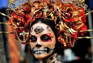 a woman in her day of the dead costume