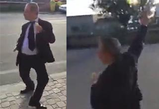 video of a man in italy that swings and fires his gun   a man dancing and swinging a gun around
