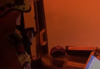 video showing new south wales firefighters trying to put out a fire but get stuck in a brushfire    firefighters braving flames in their vehicle