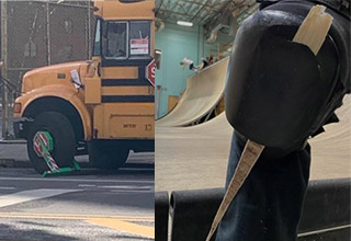 a bus with a boot on its tire and a wooden piece through a shoe