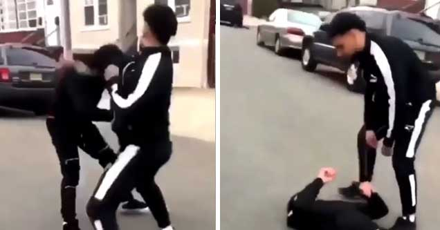 video of two men fighting in the street and it results in one of them getting knocked out and the guy still holds up his fist  | dude gets knocked out fast wearing a black tracksuit